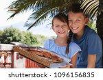 cute kids holding pizza. | Shutterstock . vector #1096156835