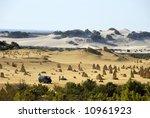 Pinnacles desert in Western Australia with camper van - stock photo