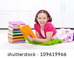 Happy young girl reading a book - back to learning and school - stock photo