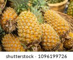 pile of pineapple for sale on... | Shutterstock . vector #1096199726