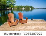 two muskoka chairs sitting on a ... | Shutterstock . vector #1096207022