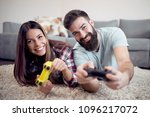 young couple playing video... | Shutterstock . vector #1096217072