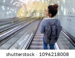 young woman on subway escalator | Shutterstock . vector #1096218008