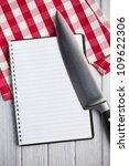 the blank recipe book with kitchen knife - stock photo