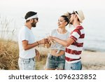 group of happy young people at... | Shutterstock . vector #1096232852