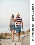 young loving couple walking on ... | Shutterstock . vector #1096232855