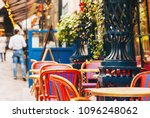 cosy street with round tables... | Shutterstock . vector #1096248062