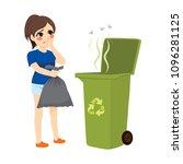 woman holding stinky trash bag... | Shutterstock .eps vector #1096281125