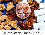 Small photo of lumps of sugar for sweets on blue kitchen table background