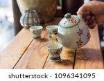 hand of man holding ceramic hot ... | Shutterstock . vector #1096341095