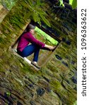 Woman Crouches In A Moss...