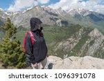 woman standing on mountain... | Shutterstock . vector #1096391078