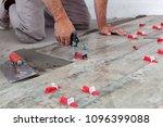 ceramic tiles. tiler placing... | Shutterstock . vector #1096399088