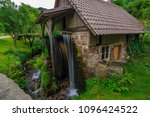 a small water mill in germany ... | Shutterstock . vector #1096424522