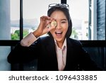 funny businesswoman holding a... | Shutterstock . vector #1096433885