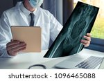 doctor watching a x ray of... | Shutterstock . vector #1096465088