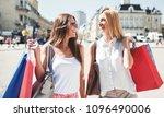 two smiling women enjoying in... | Shutterstock . vector #1096490006