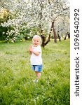 small child walks in the park... | Shutterstock . vector #1096540292