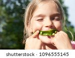 portrait of child girl eating... | Shutterstock . vector #1096555145