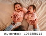 happy baby girls lying on the... | Shutterstock . vector #1096558118