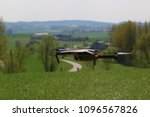 a generic drone hoovering over... | Shutterstock . vector #1096567826