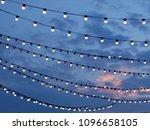 Sunset Scene Of Light Bulbs On...
