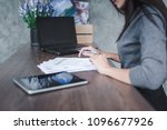 woman hand signing a contract | Shutterstock . vector #1096677926