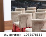 Rows Of Brown And Black Chairs...