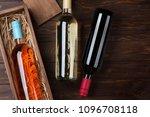 wine bottles on wooden table.... | Shutterstock . vector #1096708118