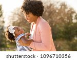 mother and daughter playing and ... | Shutterstock . vector #1096710356