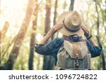 a woman with a backpack and a... | Shutterstock . vector #1096724822