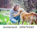 young woman with her old dog... | Shutterstock . vector #1096791065