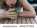 midsection of woman drinking... | Shutterstock . vector #1096797902