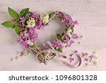 lilac flowers in wicker heart... | Shutterstock . vector #1096801328