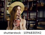 a woman is drinking juice and... | Shutterstock . vector #1096830542