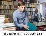 positive man customer holding... | Shutterstock . vector #1096854155