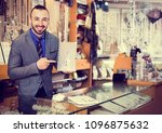 man worker seller showing...   Shutterstock . vector #1096875632