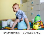smiling baby sitting on chamber ... | Shutterstock . vector #1096884752