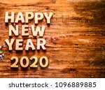Small photo of Sigh symbol Christmas Tree from a lot colorful confetti, lace and red star toy on style wooden texture background. Empty copy space for inscription. Idea of happy new year 2020 holiday. merry christm