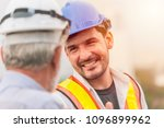 smiling engineer happy to... | Shutterstock . vector #1096899962