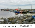 Small photo of View of old fishing boats, moored up at Kilkieran Quay, along the Wild Atlantic Way, Ireland