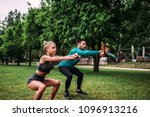 doing squats outdoors. | Shutterstock . vector #1096913216