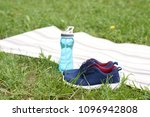 blue sneakers and water in... | Shutterstock . vector #1096942808