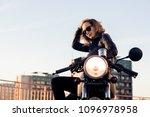 sexy biker female in black... | Shutterstock . vector #1096978958