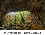 UNDARA, QUEENSLAND, AUSTRALIA - OCTOBER 21, 2014: The entrance to Arch Larva Tube in the Undara Volcanic National Park The park protects one of the longest lava tube cave systems in the world.