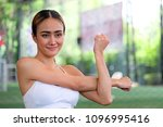 fit woman stretching body while ... | Shutterstock . vector #1096995416
