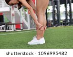 fit woman stretching body while ... | Shutterstock . vector #1096995482