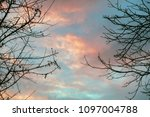 dramatic sky at sunset in the... | Shutterstock . vector #1097004788