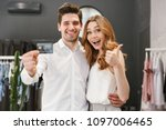 cheerful young couple shopping... | Shutterstock . vector #1097006465