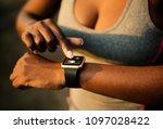woman answering a call through... | Shutterstock . vector #1097028422